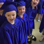 Kids in graduation costumes